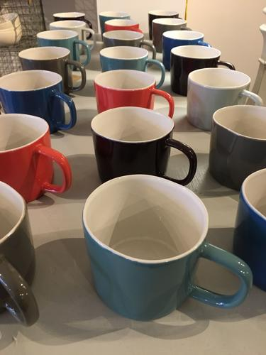 Selection of mugs in rich colours
