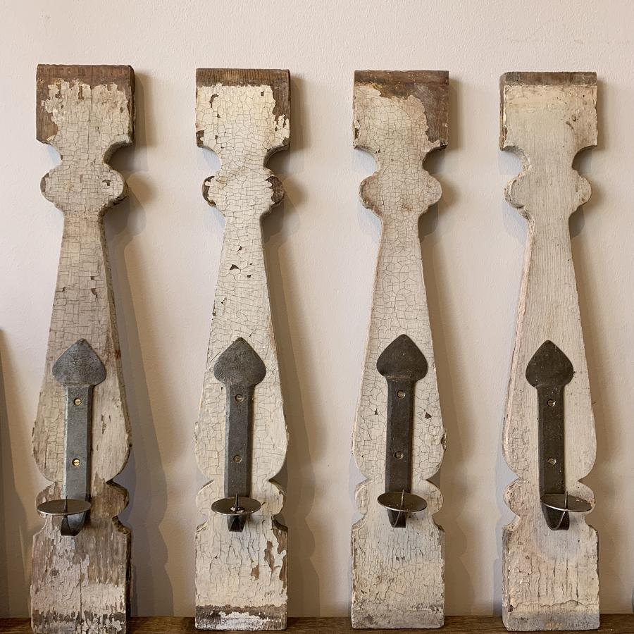 Swedish bannister posts with hand forged candle sconces