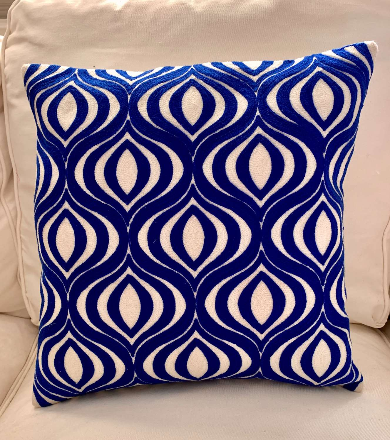 Royal blue crewel work cushion with feather pad
