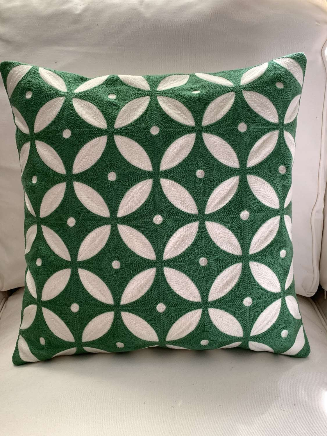 Green crewel work cushion with feather pad