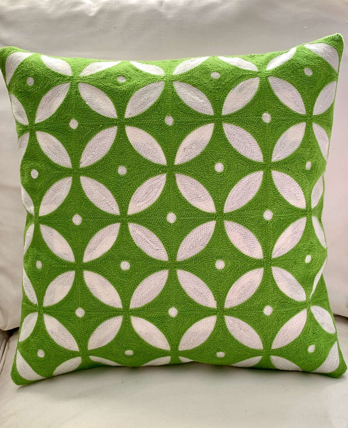 Vibrant lime green crewel work cushion with feather pad