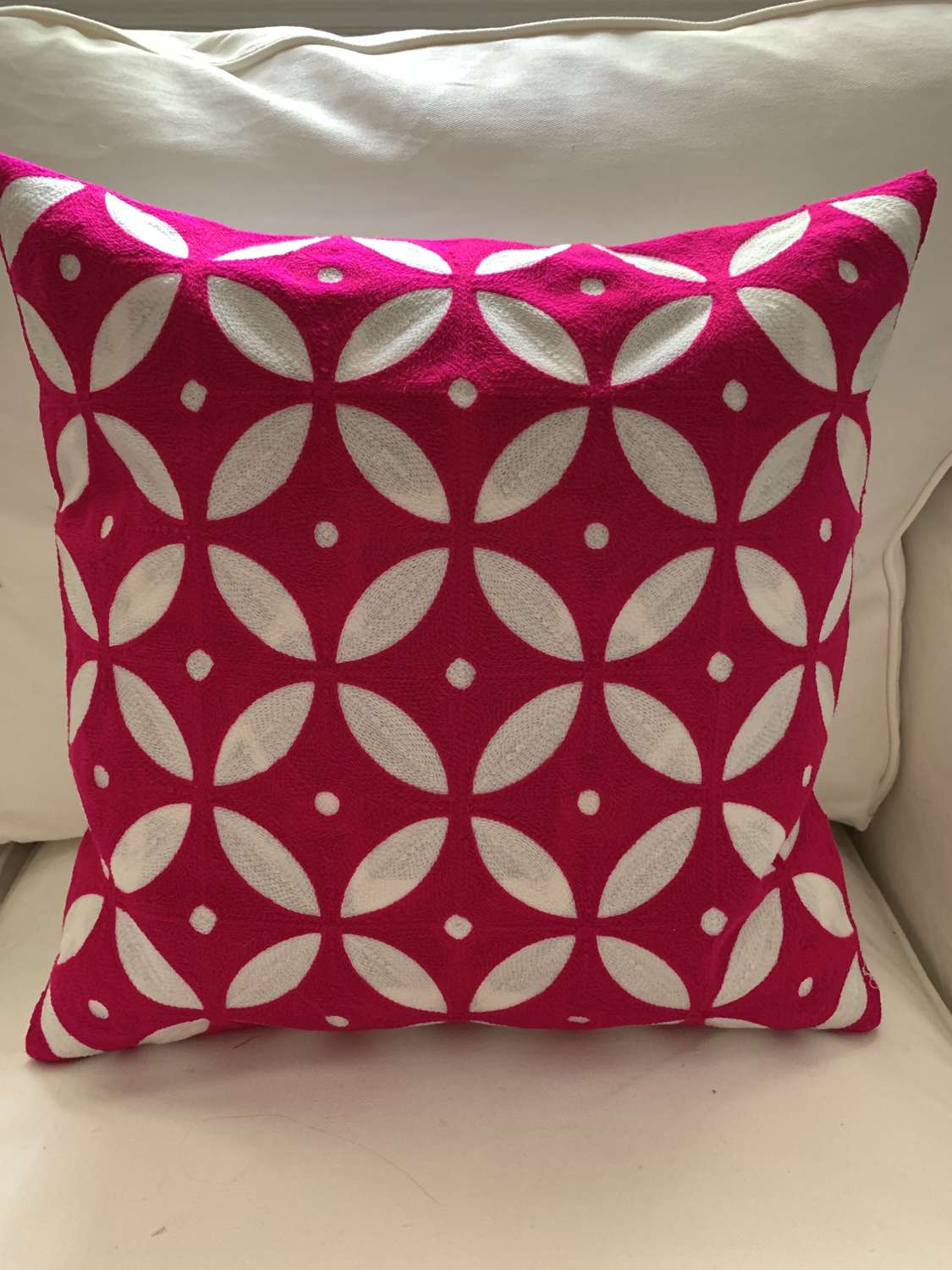 Shocking pink crewel work cushion and feather pad