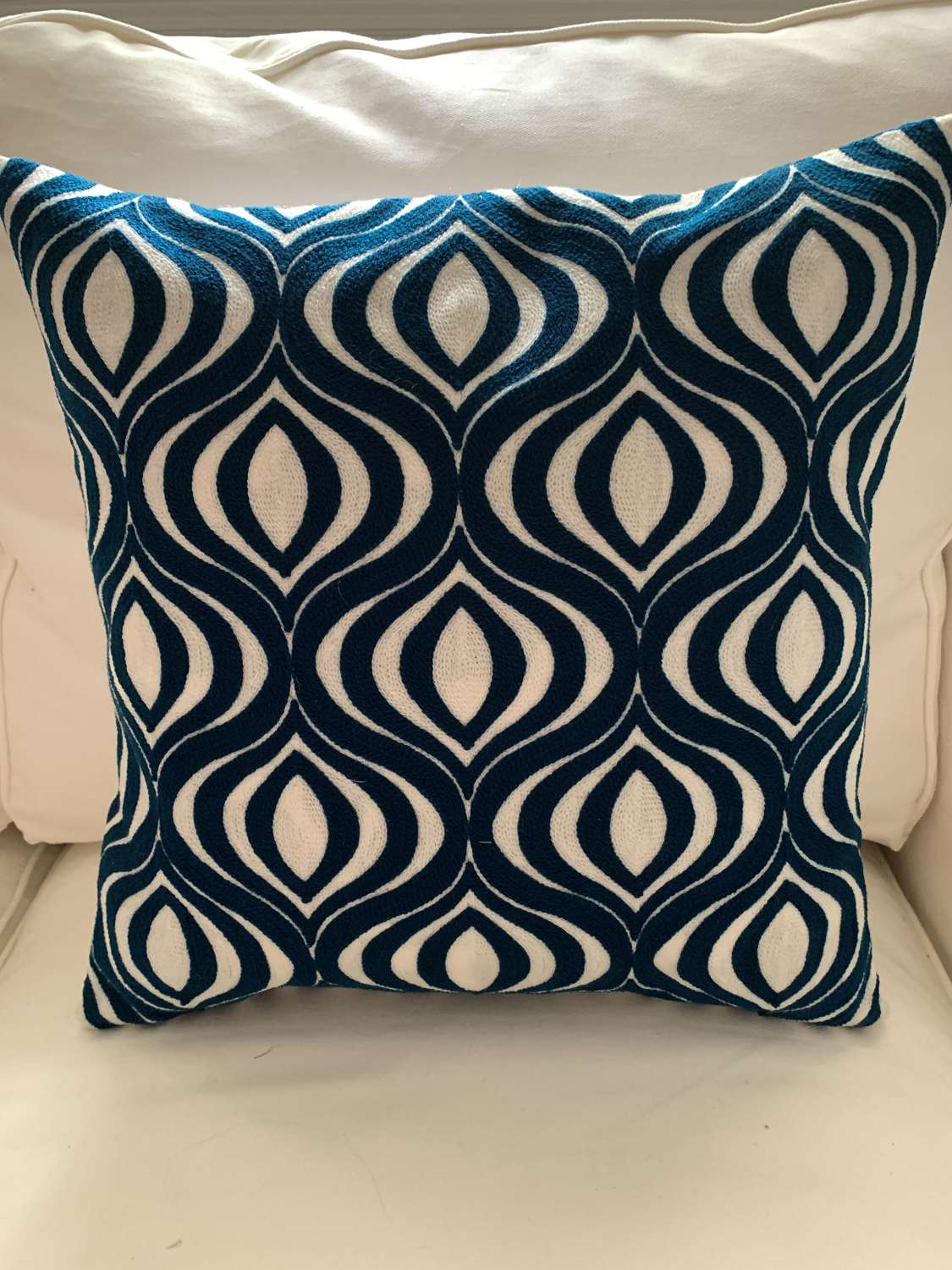 Petrol blue crewel work cushion with feather pad