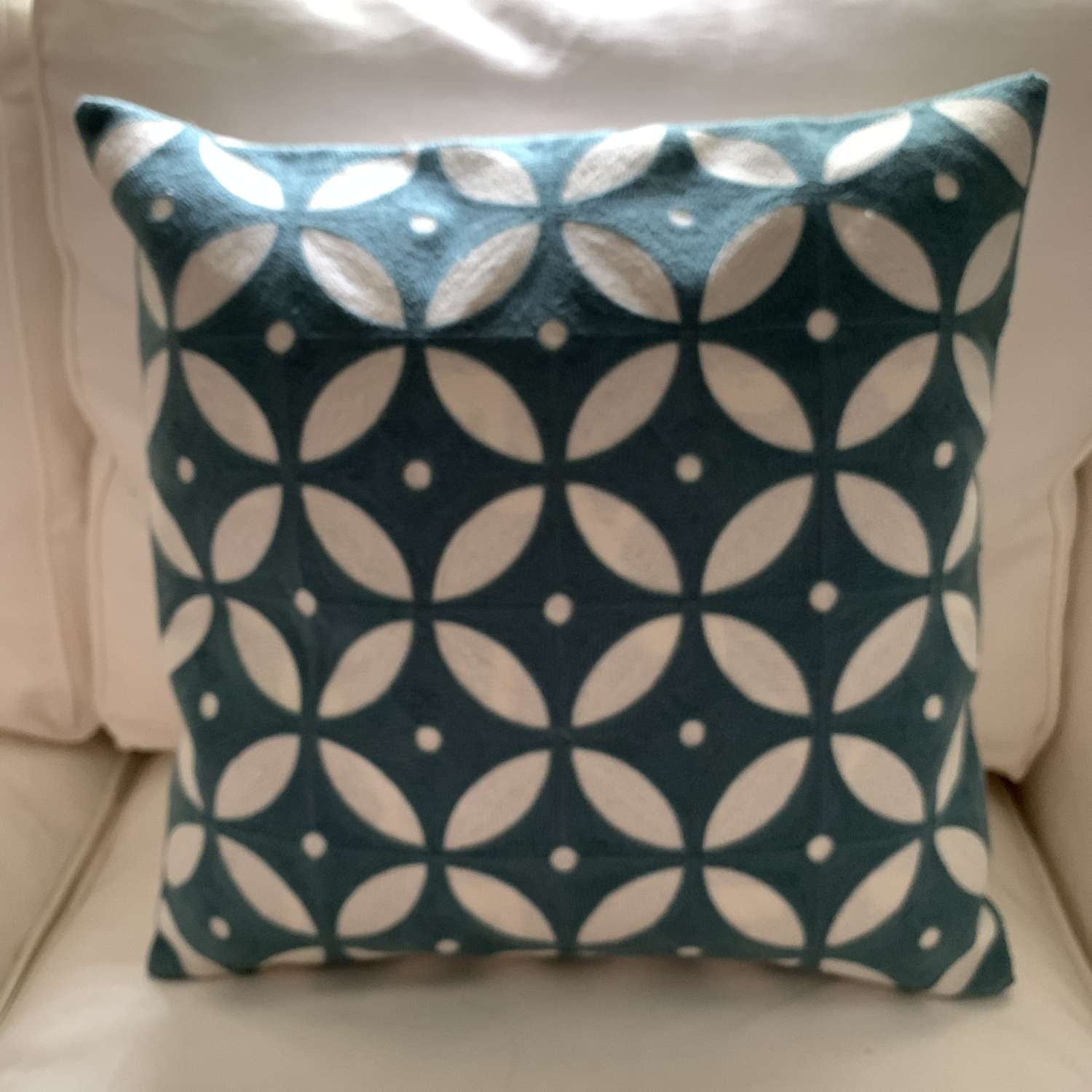 Dusky blue crewel work cushion with feather pad