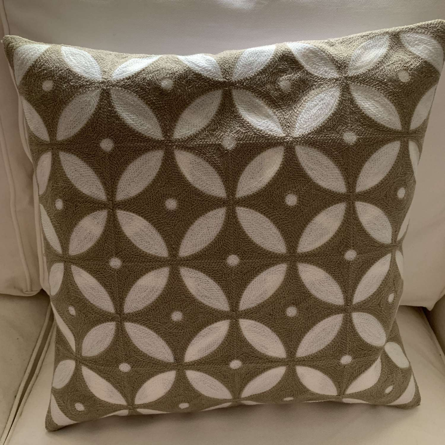 Taupe crewel work cushion with feather pad