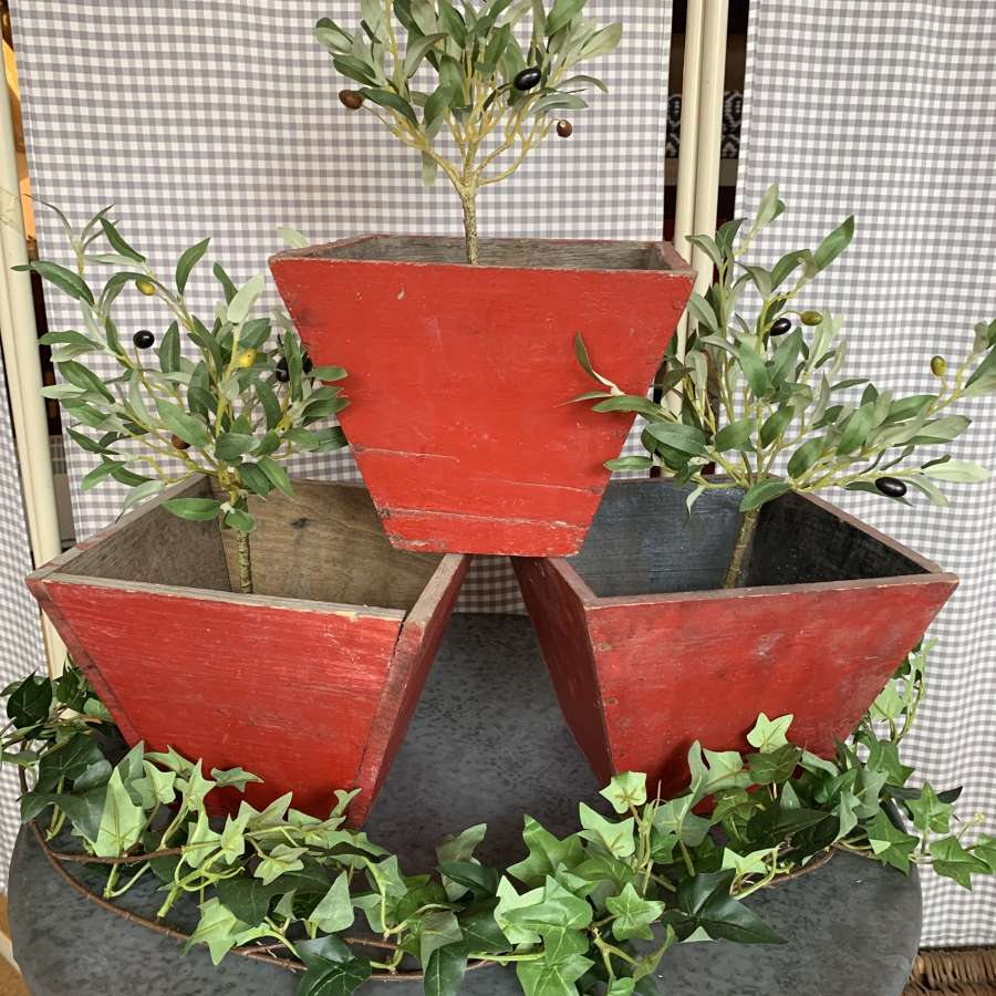 Wooden planters with original red paint