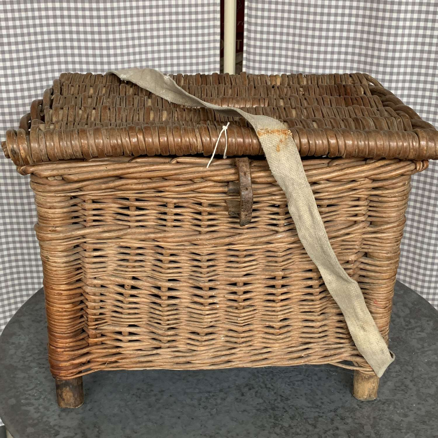 Vintage fishing basket with canvas strap