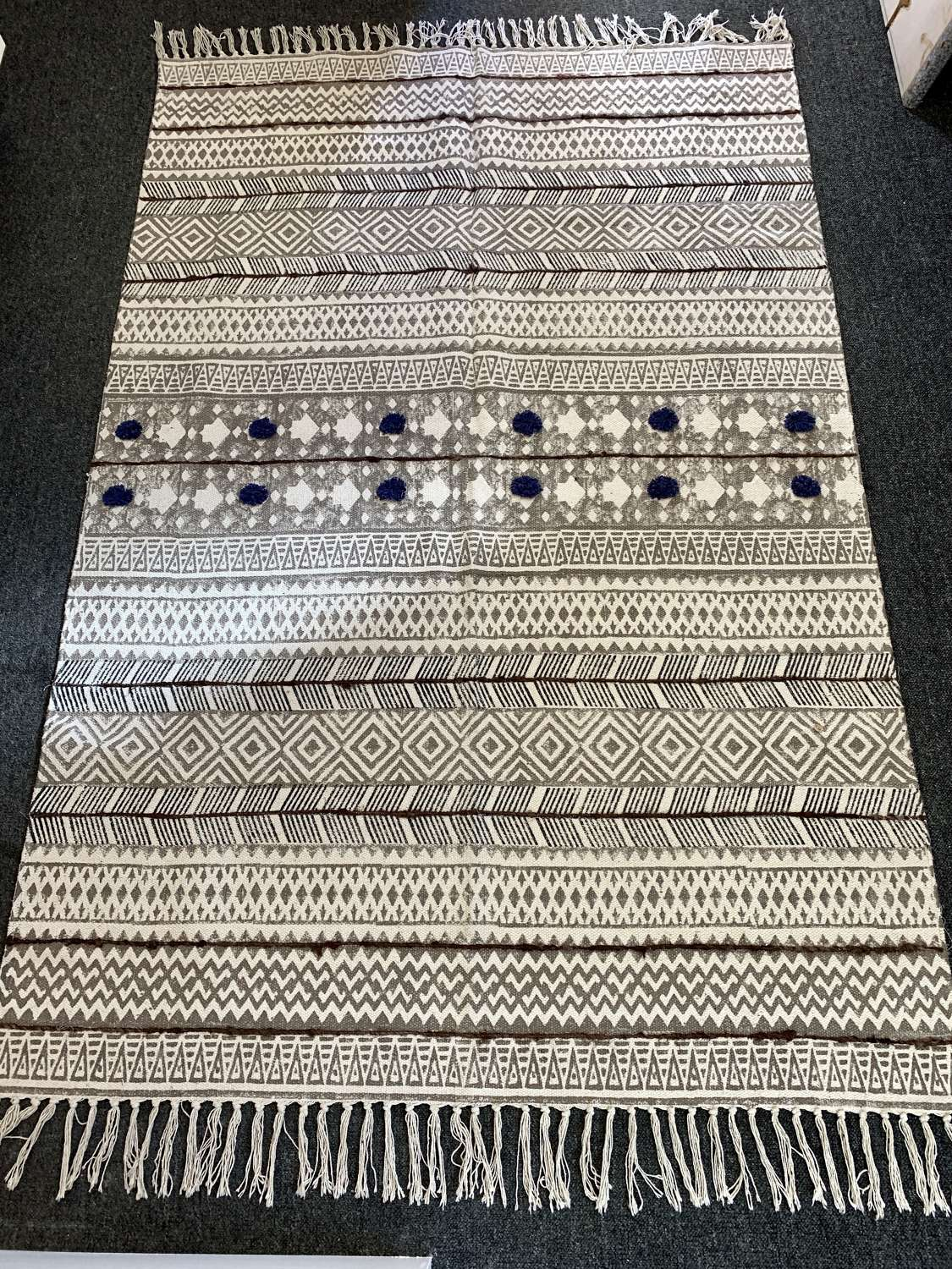 Handmade block printed rug with woollen stitching & pompoms