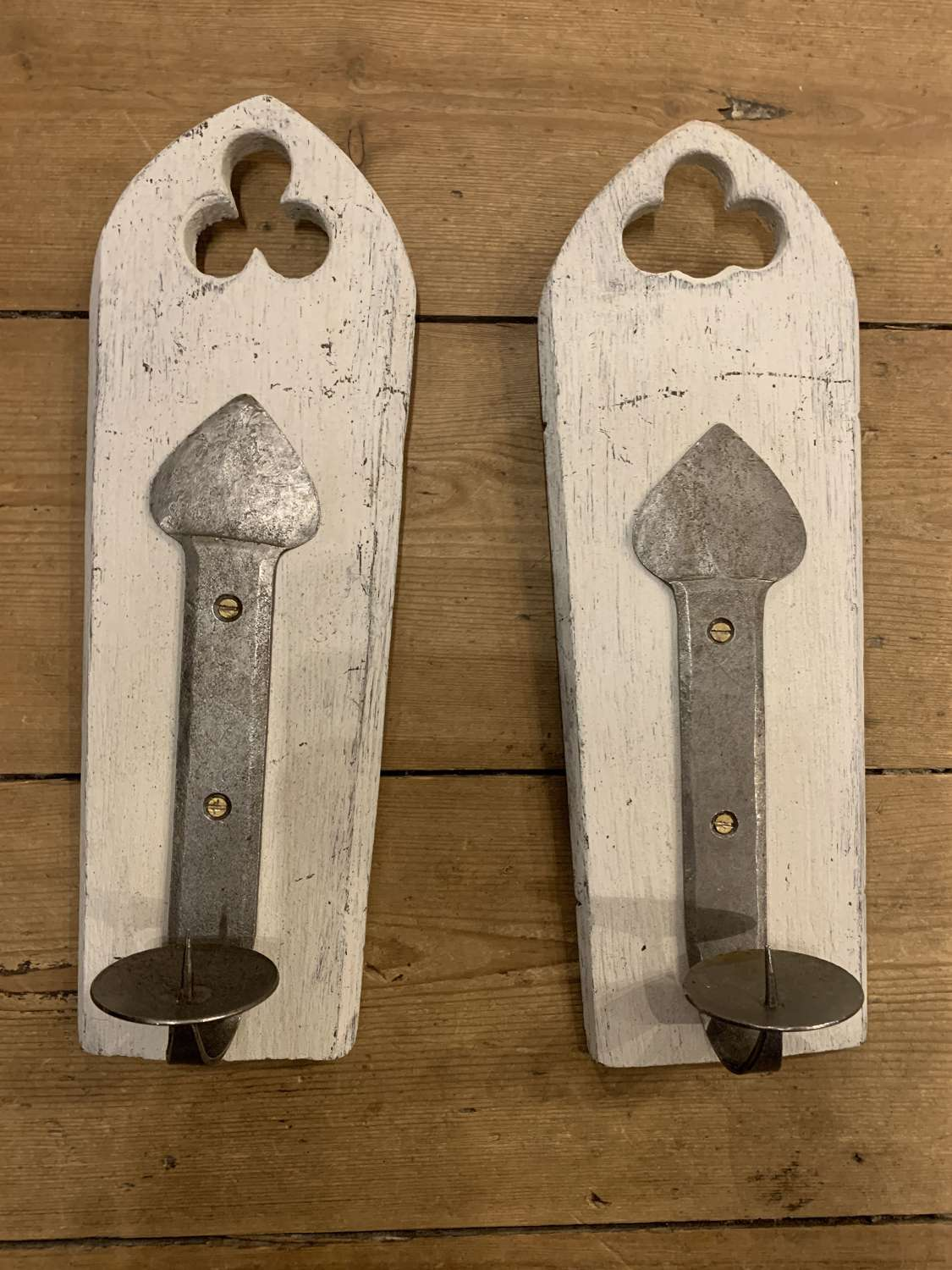 Wood and wrought iron candle sconces
