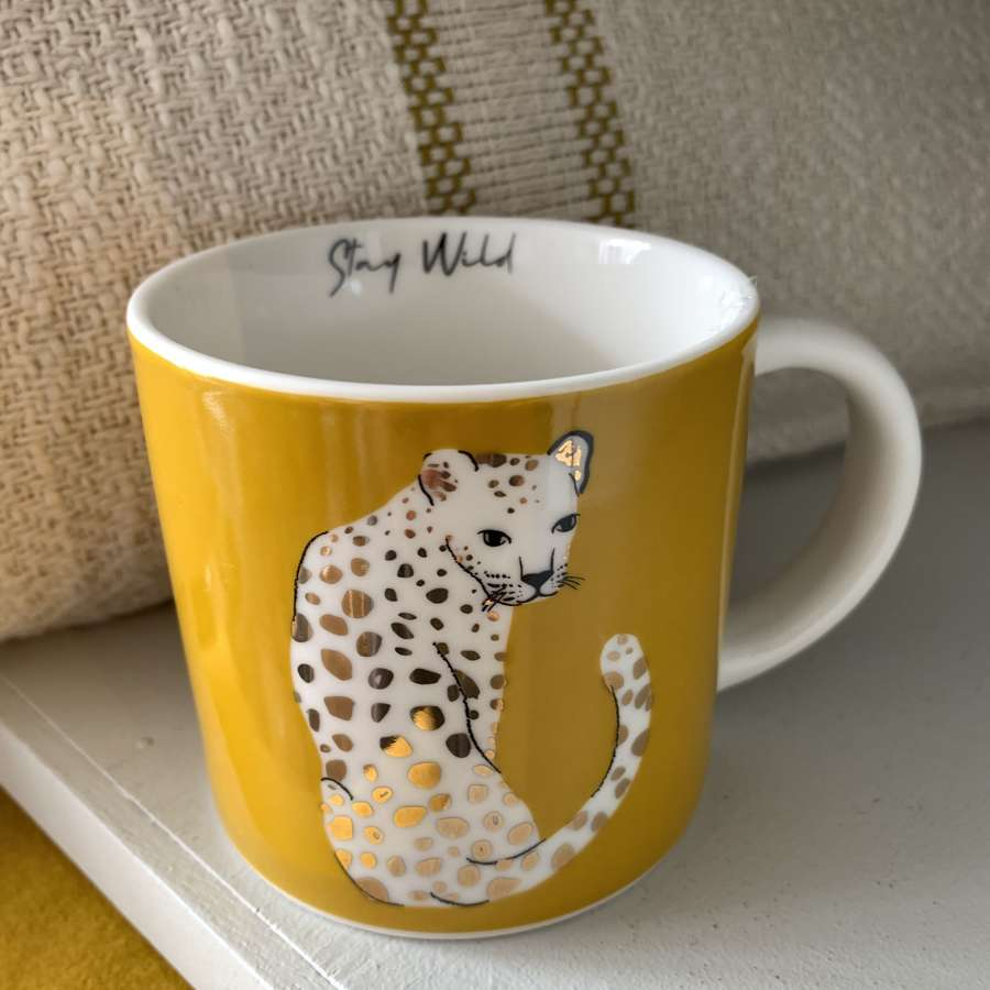 Leopard with gold spots mug - 'stay wild'