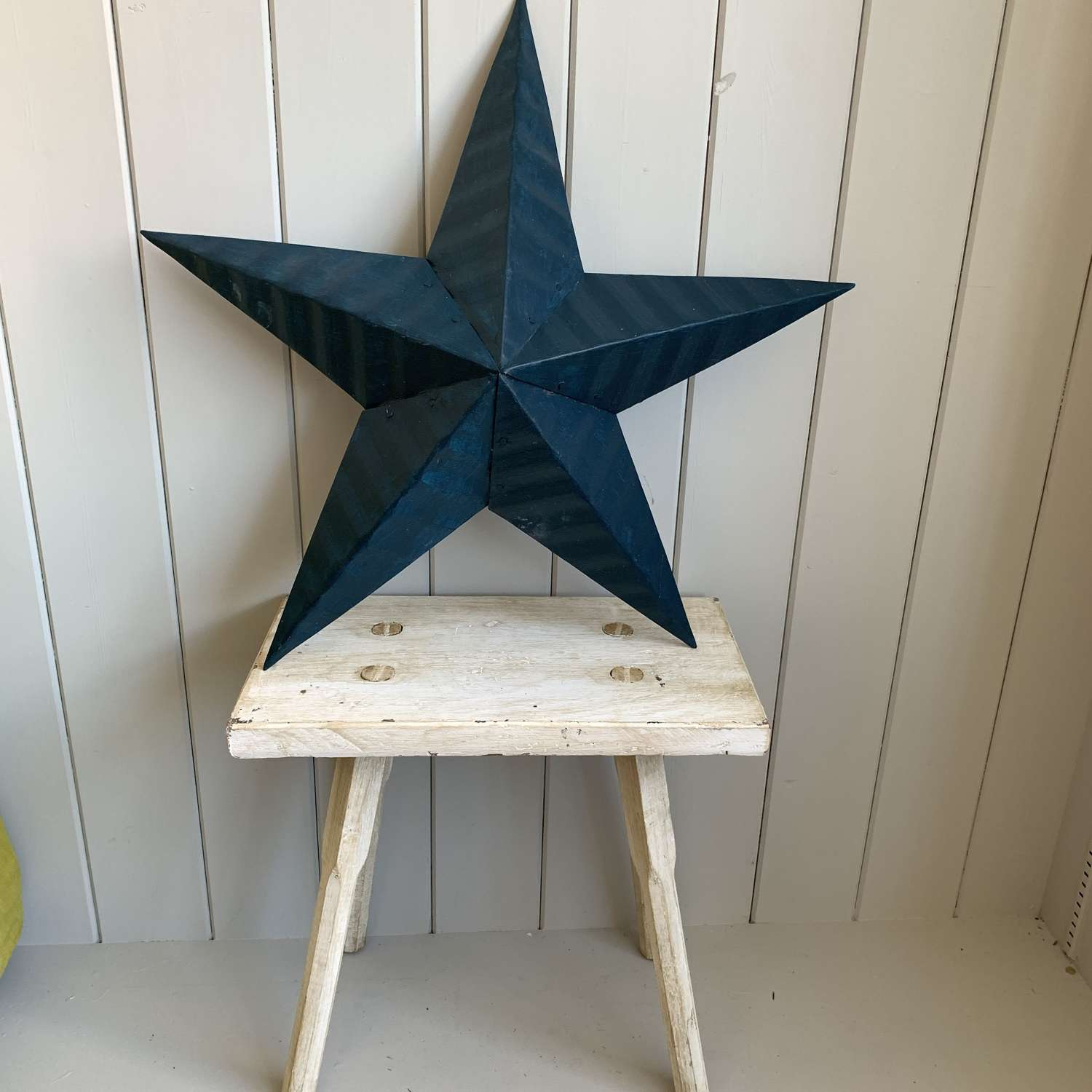 Painted blue tin Amish barn star