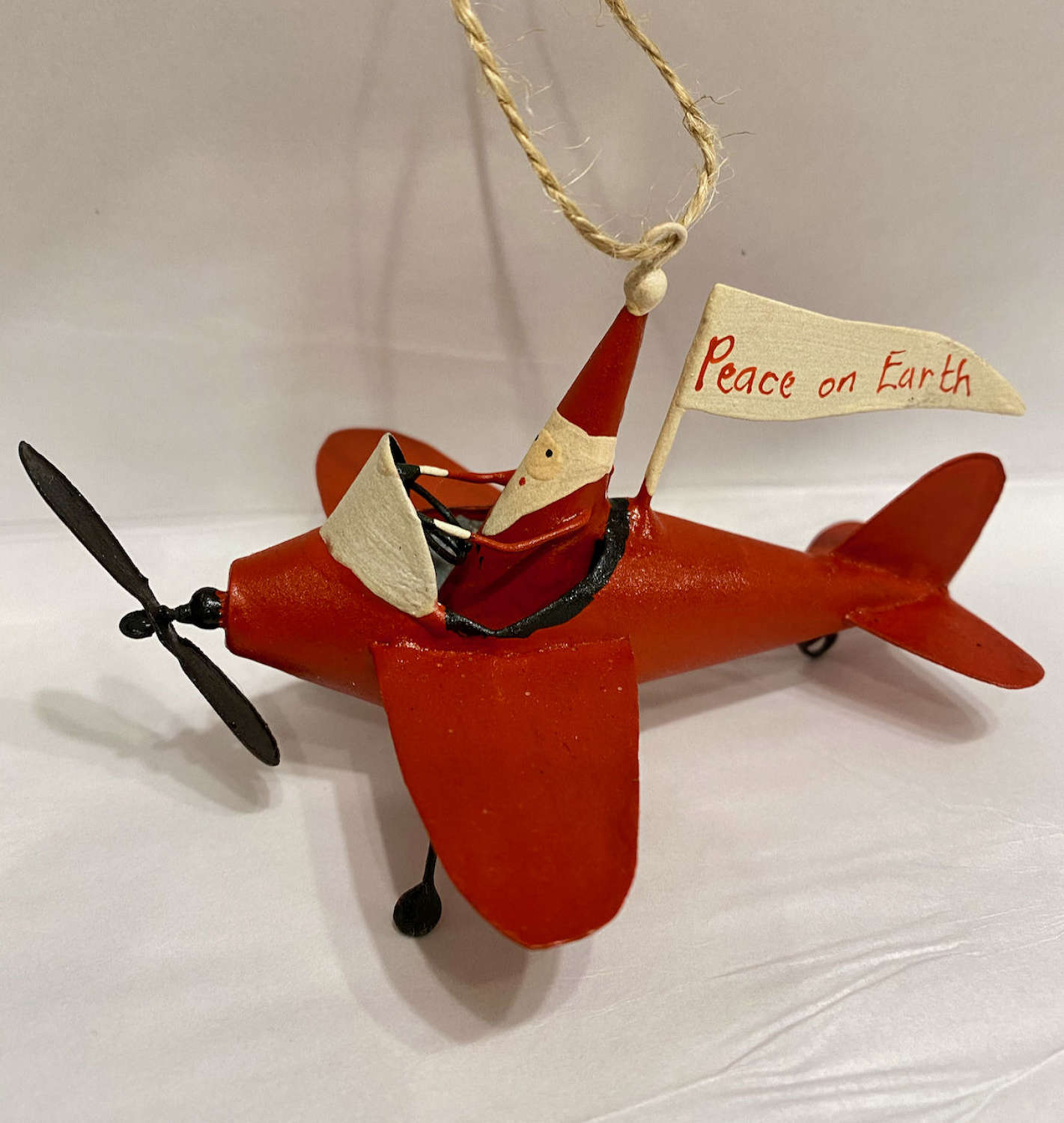 Tin Father Christmas in his Peace on Earth plane