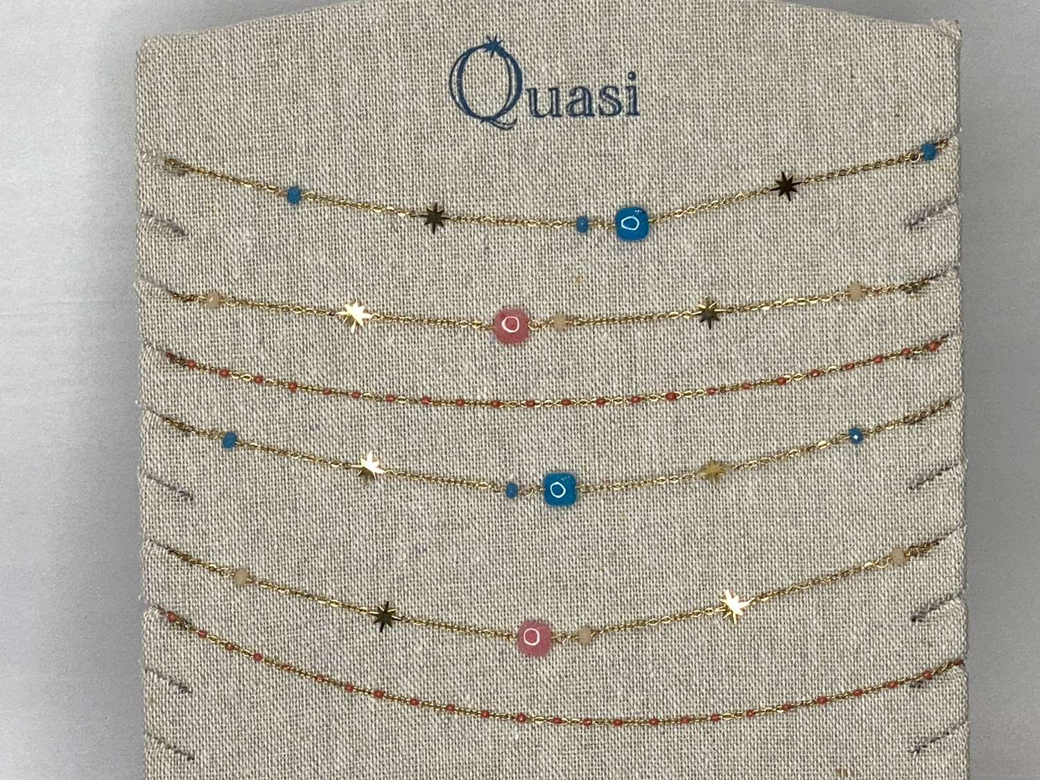 Gold (plated) necklaces with coloured stones