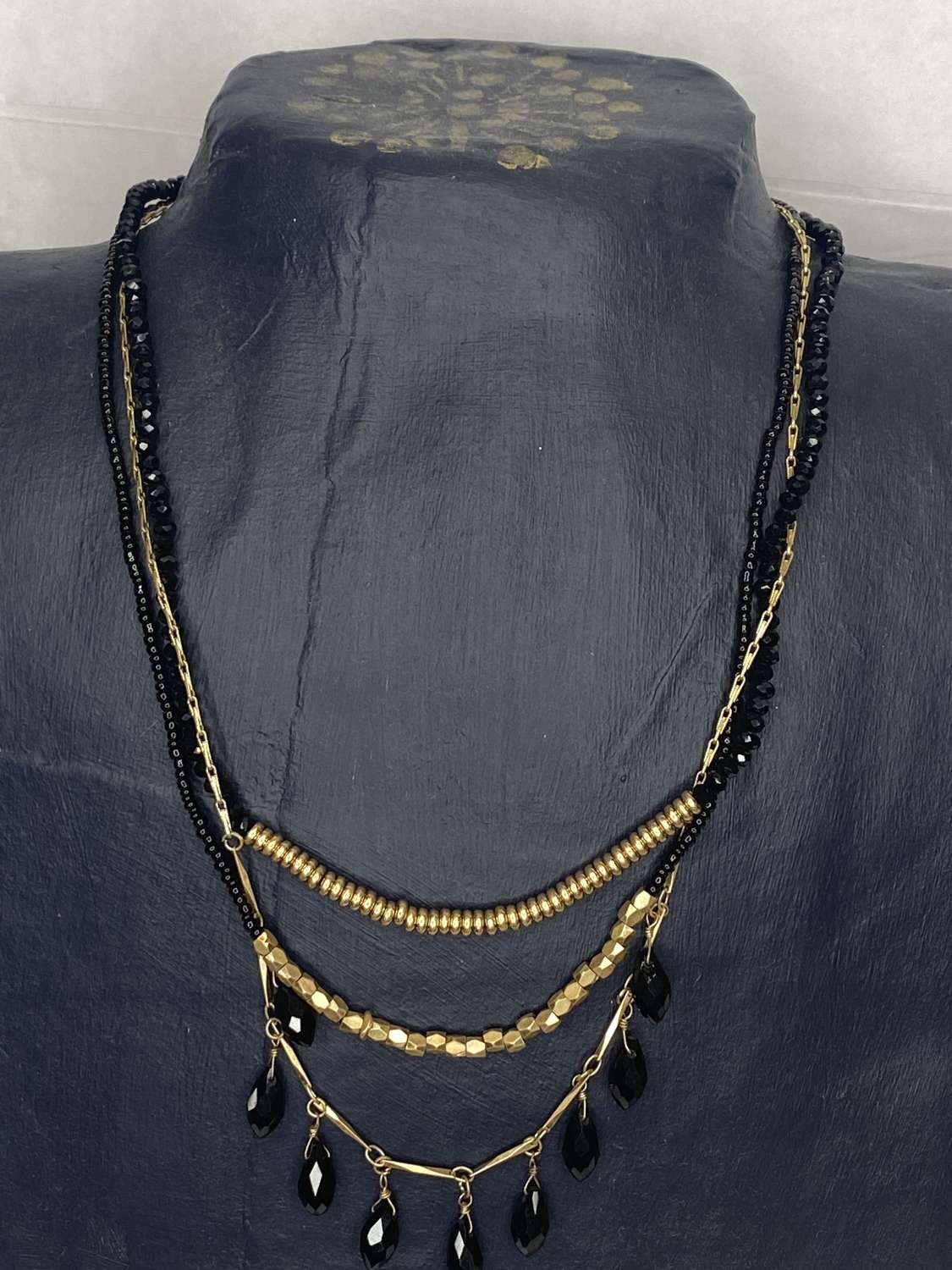 Envy black and gold multi-strand necklace