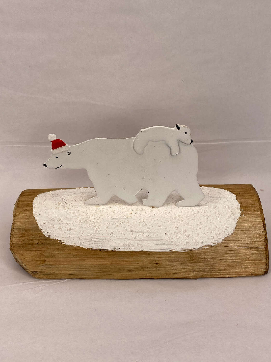 Metal polar bear mother and baby on reclaimed wood