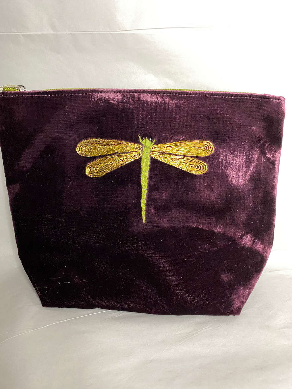Large embroidered make up bag with floral fabric lining