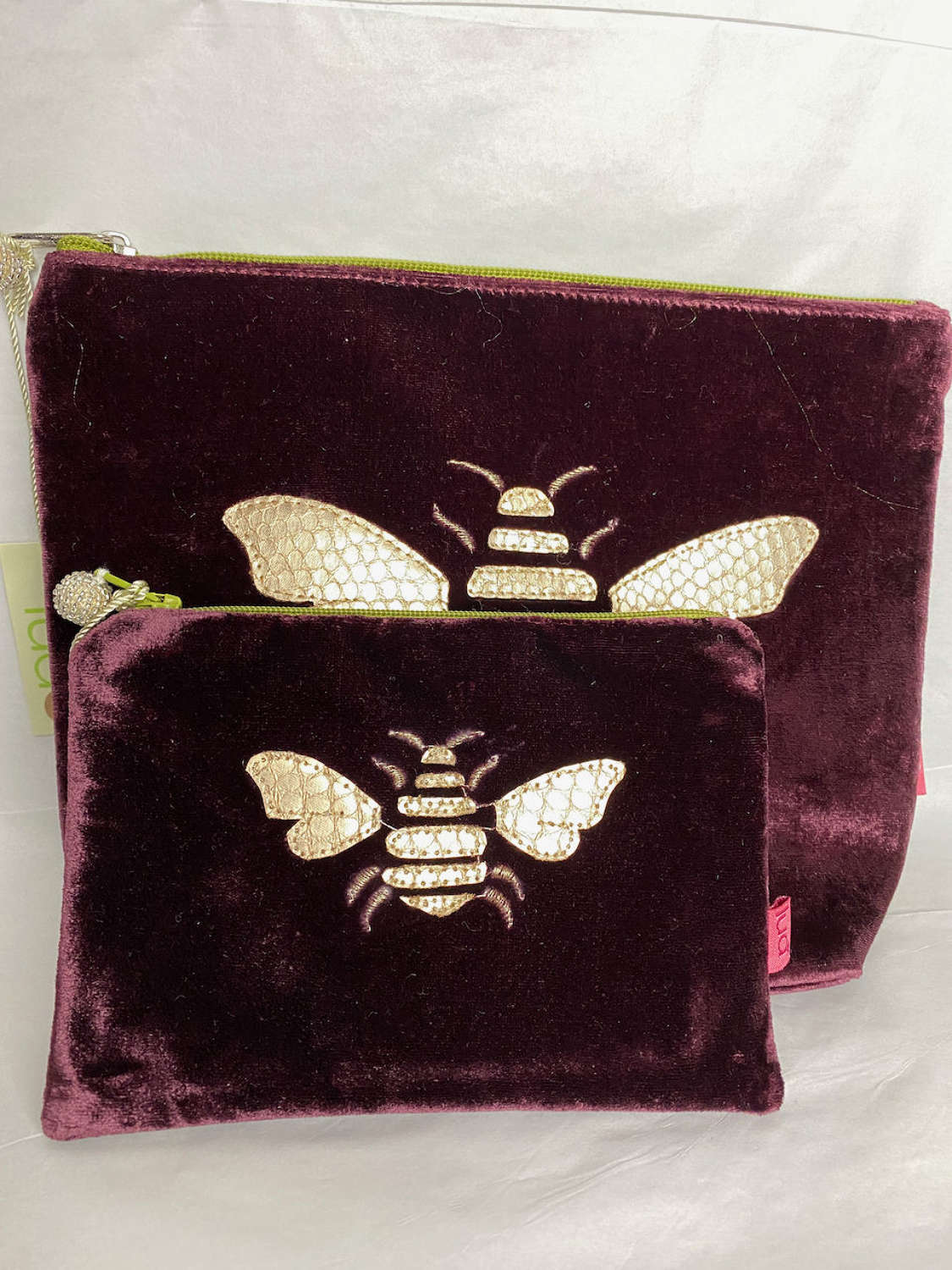 Burgundy velvet bags and purses with gold bee